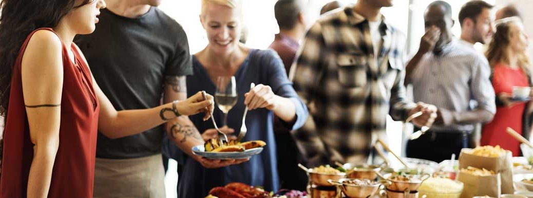 happy people enjoying catered food